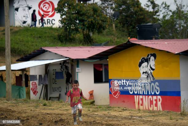 """Boy is seen at the arms-free zone known as Territorial Spaces for Training and Reincorporation """"Antonio Narino"""", where former guerrilla fighters..."""