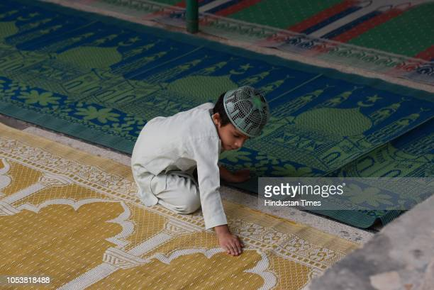 A boy is seen inside a mosque after an eightyearold student of a Madrasa died after he sustained a head injury during a scuffle between two groups of...