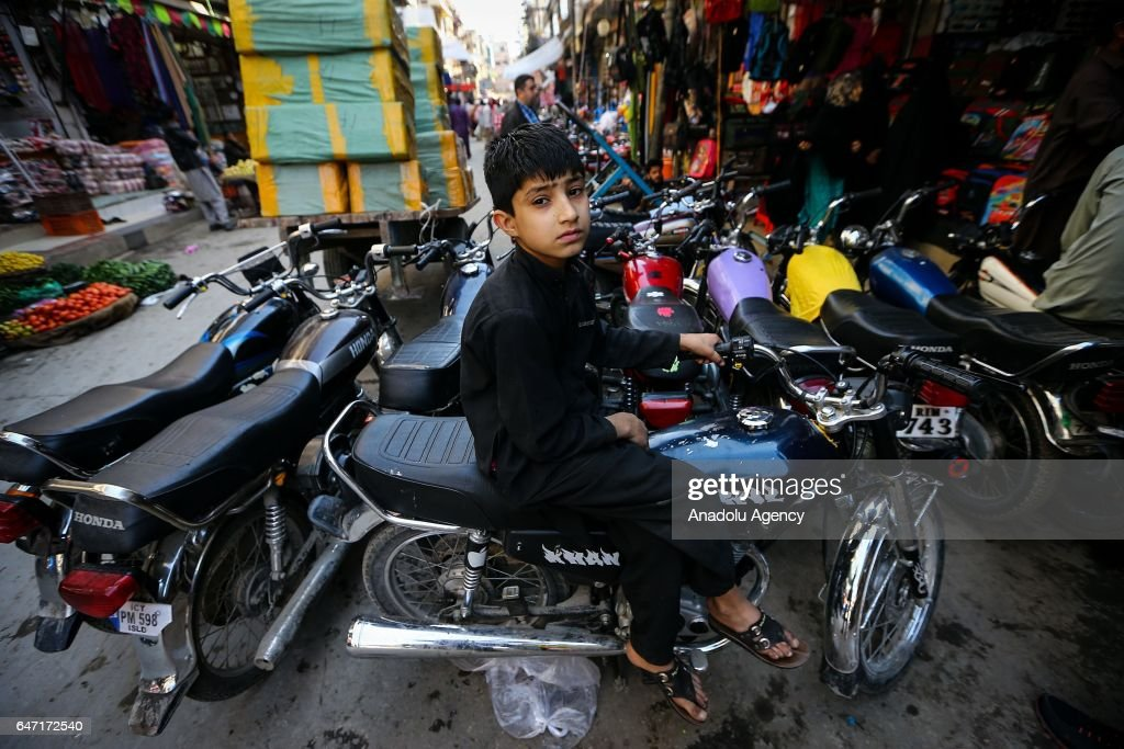 A boy is seen on his motobike at Raja market place where Pakistani people prefer shopping due to it's reasonable prices in Rawalpindi Pakistan on.