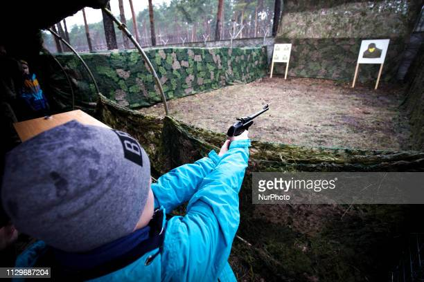 A boy is seen shooting BB guns at a shooting range at a military base in Bydgoszcz Poland on March 9 2019 The local military base organized a public...