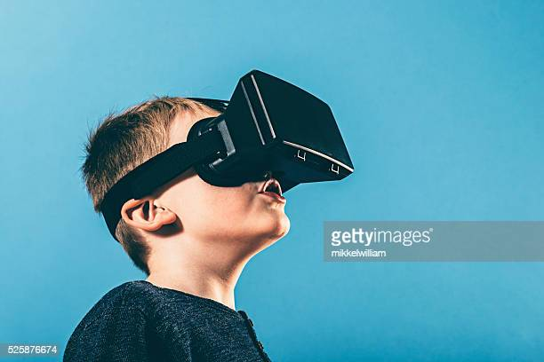 Boy is surprised by content on VR glasses