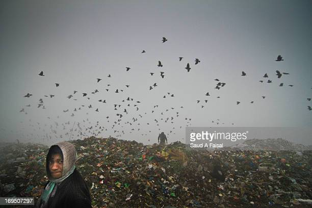 Boy is working in a wasteland or garbage yard in Dhaka, Bangladesh