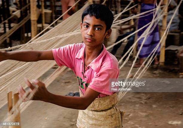 """Boy is working in the rope factory - Dhaka Bangladesh.Jute rope is made from Natural jute yarn. The best natural yarn from """"Tosha""""jute.This rope is..."""