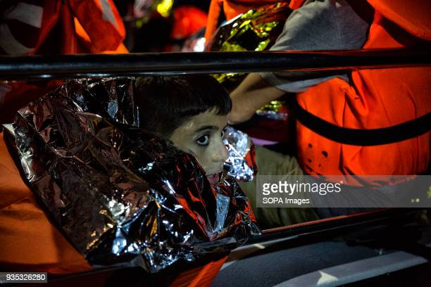 A boy is wrapped in an emergency blanket provided by rescuers as asylumseekers are brought to short after being rescued at sea In 2015 more than a...