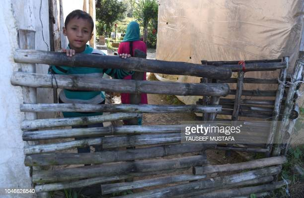 A boy ispictured during the 14th edition of the Hero MTB Himalaya mountain bike race during a final day at Dharamshala in the northern Indian state...
