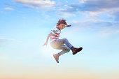 boy jumping in air