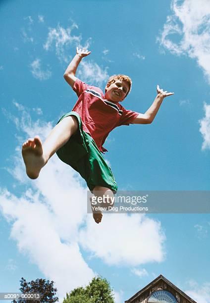 Boy Jumping in Sky
