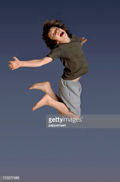 Boy jumping in the air with bare feet