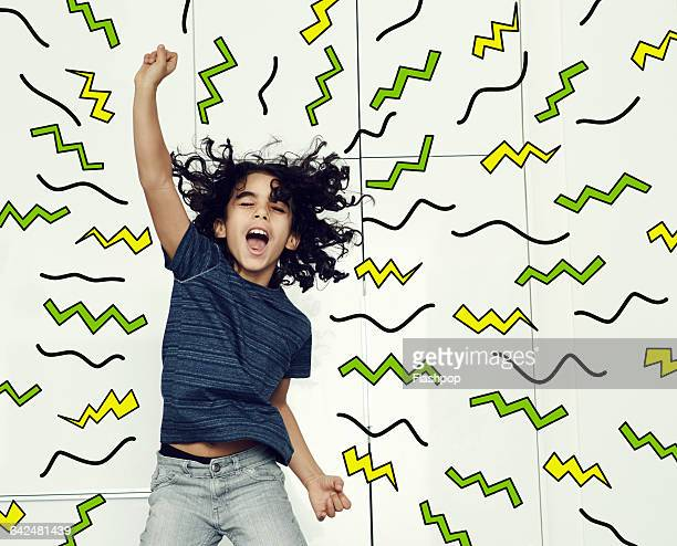 boy jumping in the air with graphic symbols - moving activity stock pictures, royalty-free photos & images