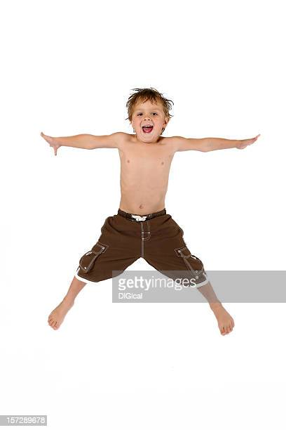 Boy Jumping In The Air With His Arms Spread Out