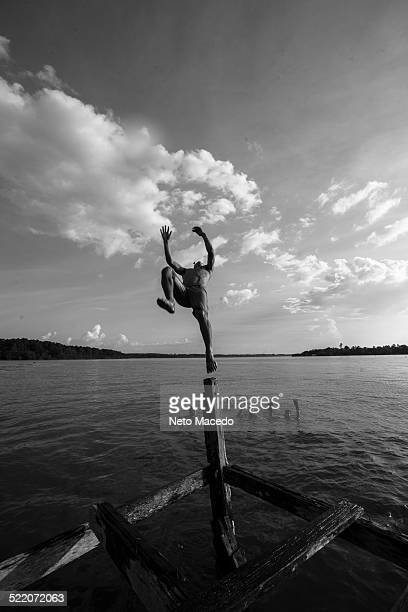 Boy jumping in the water