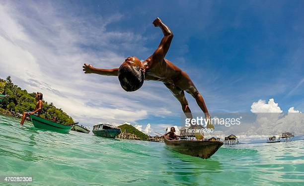boy jumping into clear sea water, malaysia - sabah state stock pictures, royalty-free photos & images