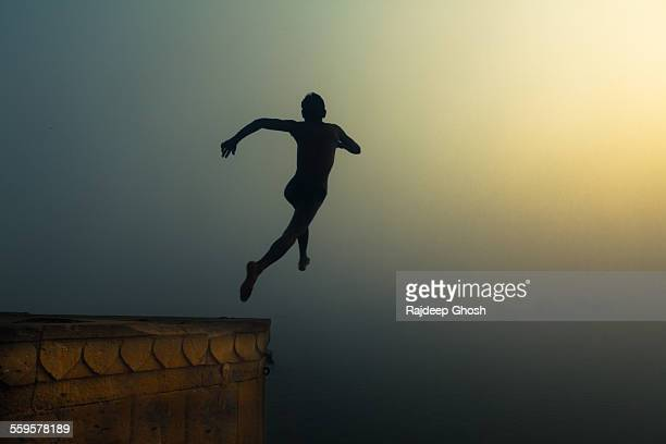leap of faith in varanasi - leap of faith stock photos and pictures