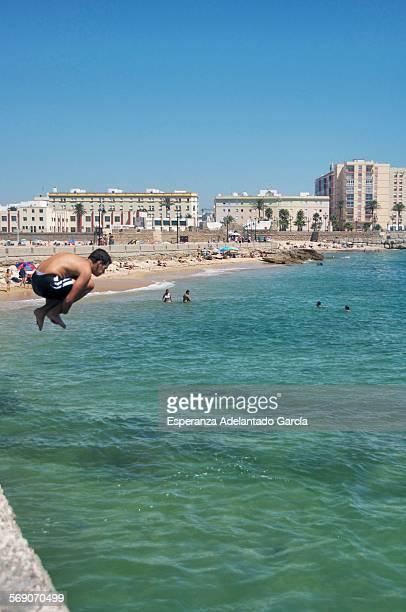 Boy jumping into the sea Cadiz Spain