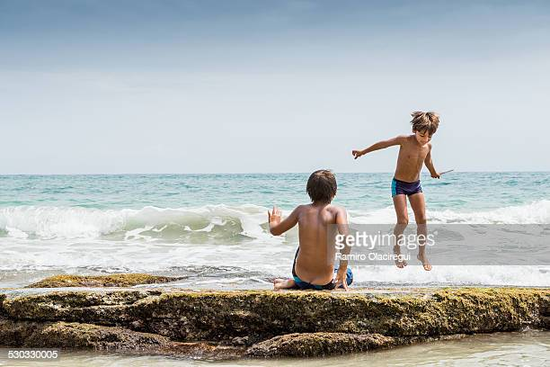 Boy jumping on a wave