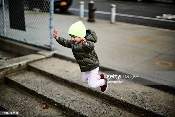 Boy Jumping On Steps