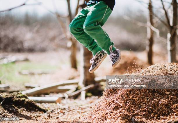 boy jumping - human foot stock pictures, royalty-free photos & images