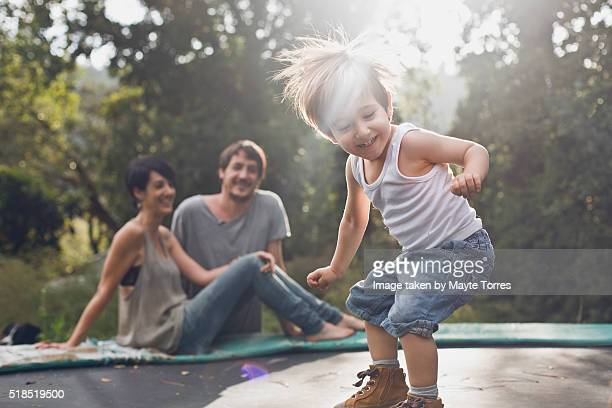 Boy jumping with parents