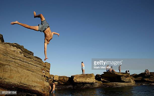 A boy jumps into a rock pool in Coogee to cool off on February 25 2016 in Sydney Australia The bureau of meteorology forecast temperatures over 40...