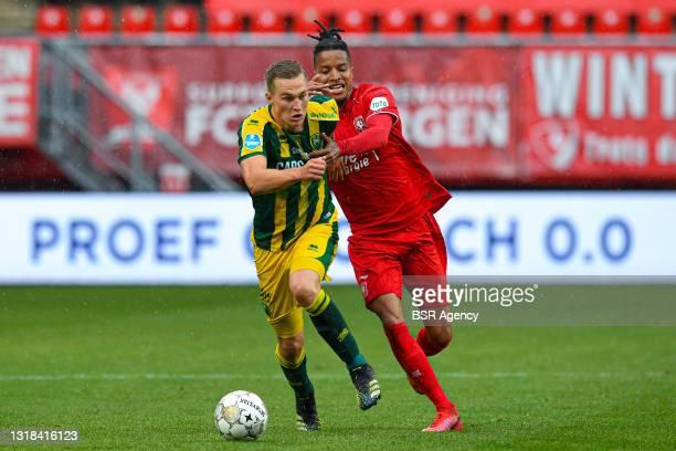 Boy Kemper of ADO Den Haag, Tyronne Ebuehi of FC Twente battle for possession during the Dutch Eredivisie match between FC Twente and ADO Den Haag at...