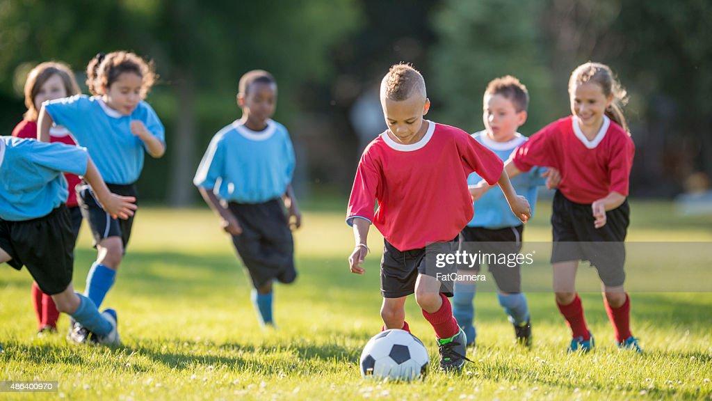 Boy Kicking a Soccer Ball : Stock Photo