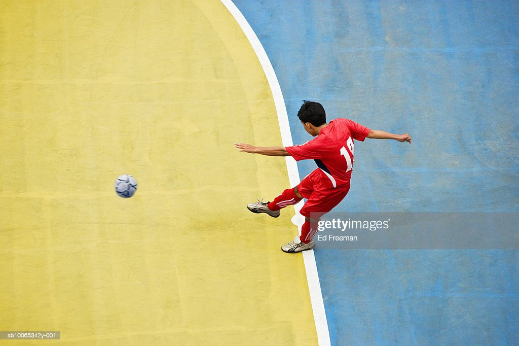 Boy kicking soccer ball, elevated view : Foto stock