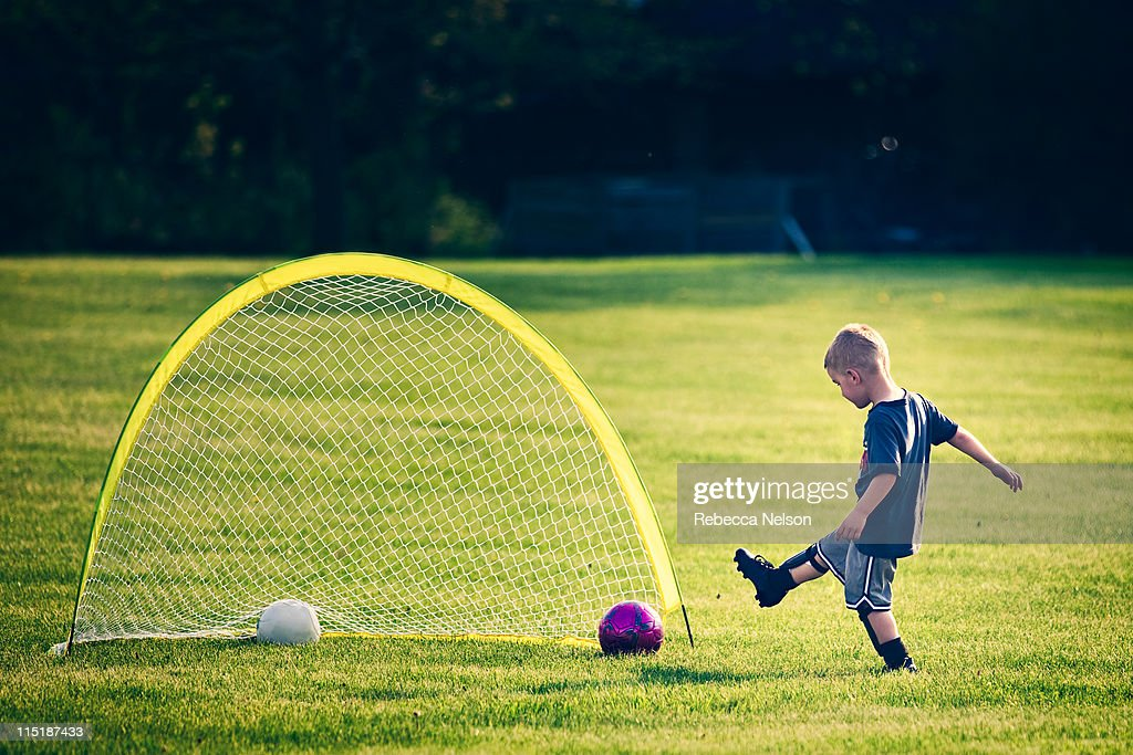 kicking the soccer ball in the goal