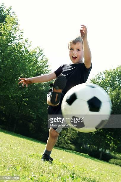 Boy kicking the ball!