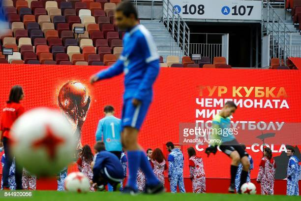 A boy kicks the ball ahead the official kickoff ceremony for the 2018 FIFA World Cup Trophy Tour at Luzhniki Stadium in Moscow Russia on September 09...