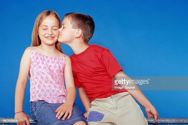 Boy kissing girl on the cheek