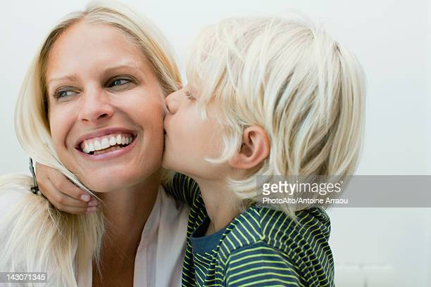 boy kissing his mother on the cheek - cheek stock pictures, royalty-free photos & images
