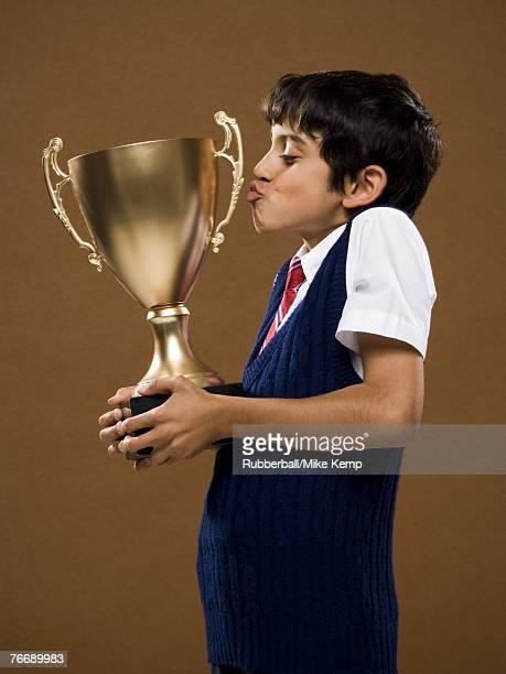Boy kissing trophy cup