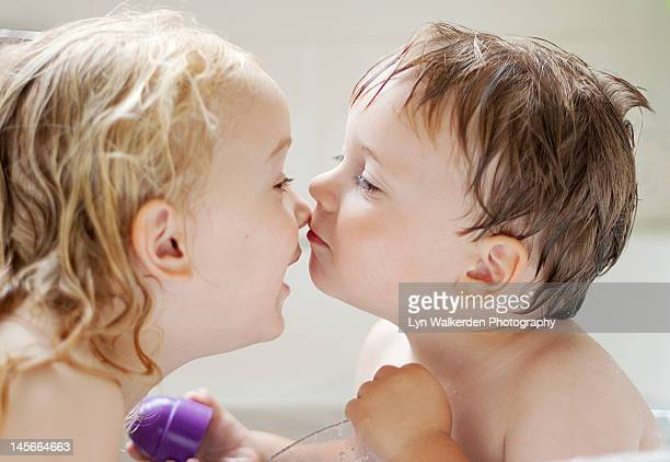 Boy kissing with his sister