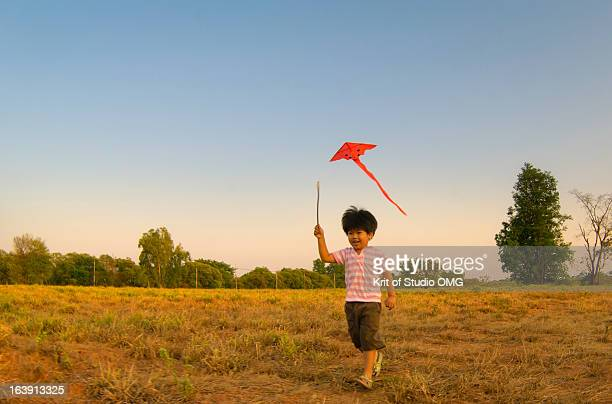 Boy & Kite in the rural field
