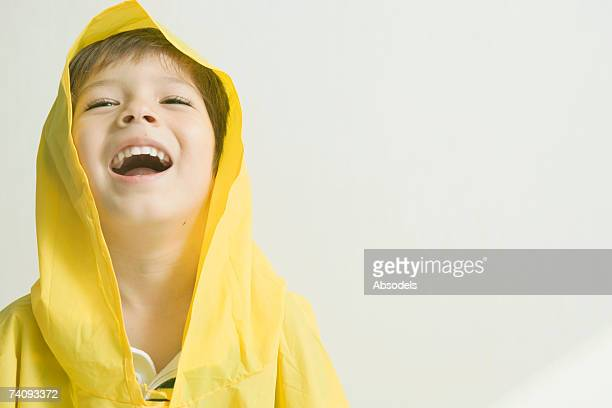 A Boy Laughing In A Raincoat