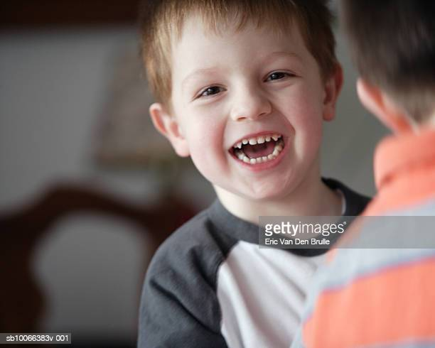 boy (4-5) laughing - eric van den brulle stock pictures, royalty-free photos & images