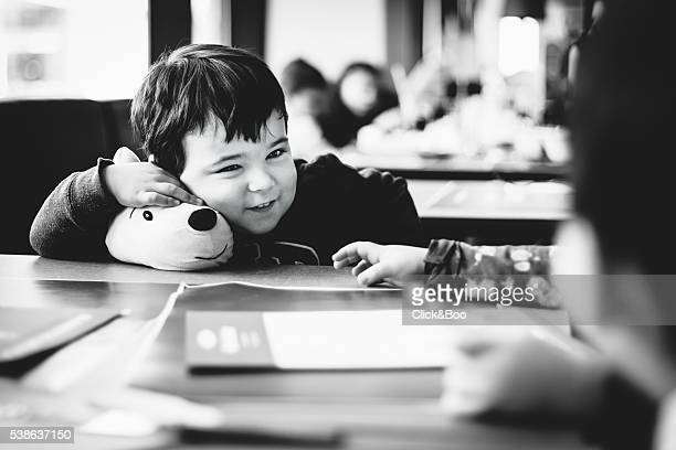 Boy laughing with a soft toy