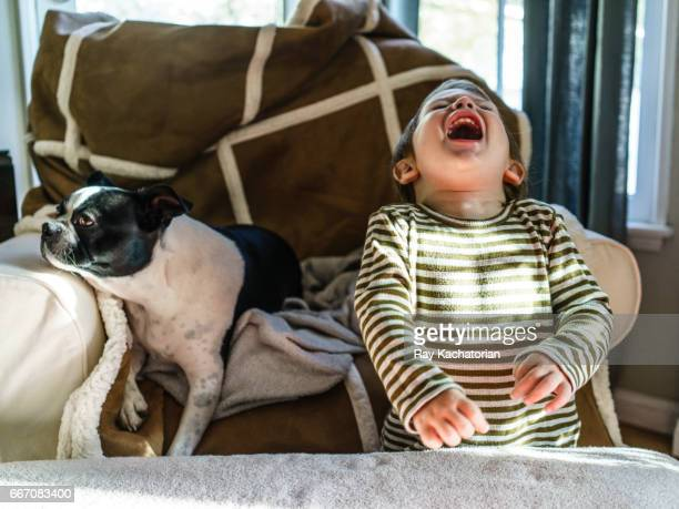 Boy laughing with dog