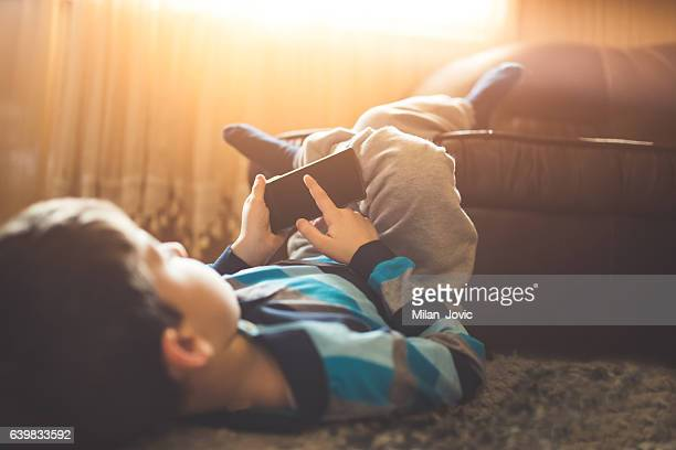 boy lay on the floor in the room - human body part stock pictures, royalty-free photos & images