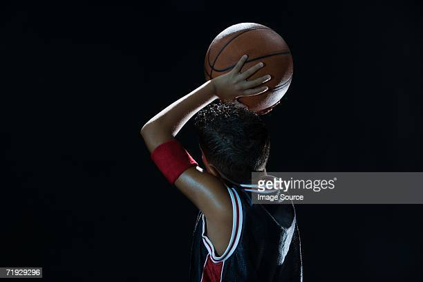 Boy laying basketball