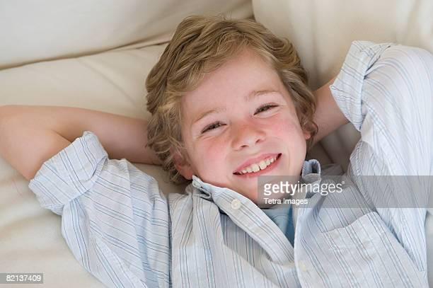 Boy laying on sofa