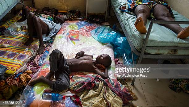 A boy lays on a mattress on the floor inside the Redemption Hospital which has become a transfer and holding center to intake Ebola patients located...