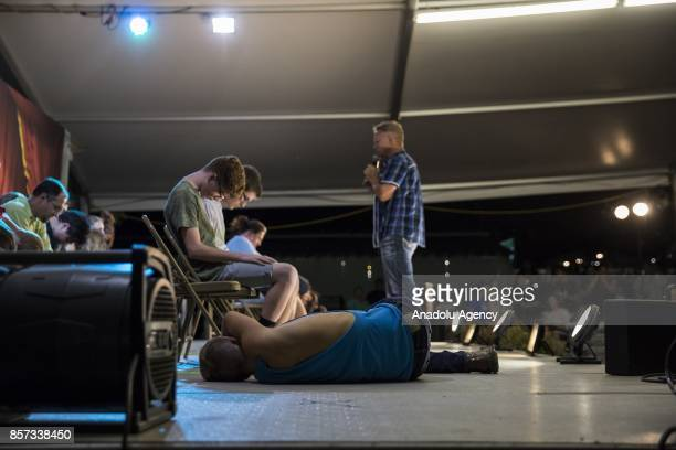 A boy lays on the stage after falling out of his chair while hypnotized during a comedy show at the Montgomery County Agricultural Fair in...