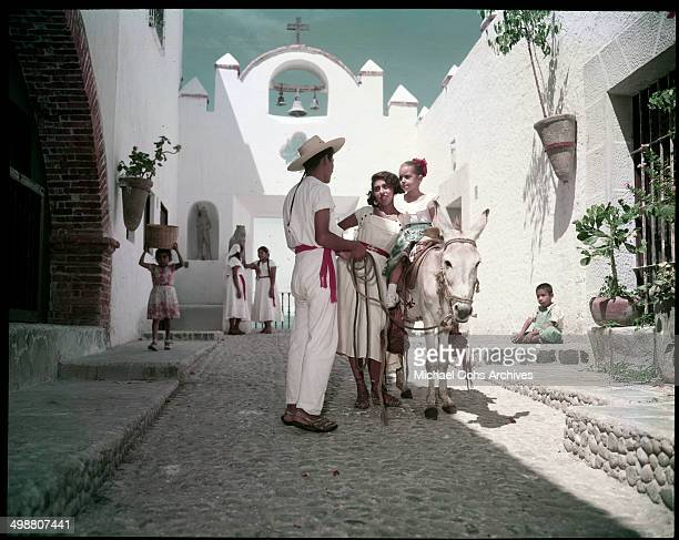 A boy leads a girl on a donkey ride in Acapulco Mexico in July 1953