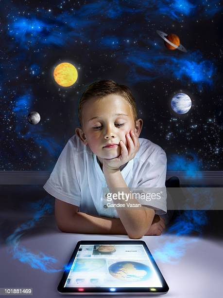 boy learning from tablet computer - all shirts stock-fotos und bilder