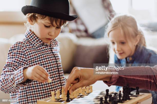 a boy learning how to play chess - tag game stock photos and pictures