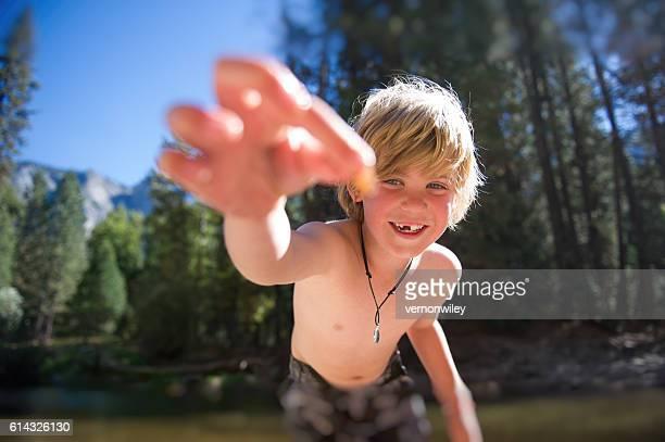 Boy learning in Yosemite, Ca