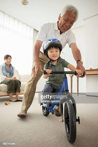Boy learning to ride bicycle