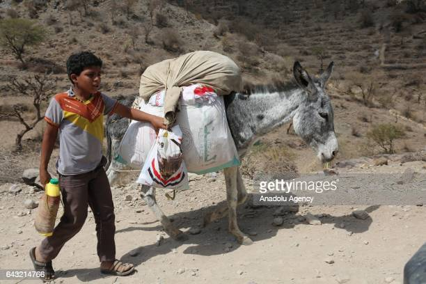 Boy leaves the village with his belongings after Houthis captured Tubeysia village in Taiz province, Yemen on February 20, 2017.