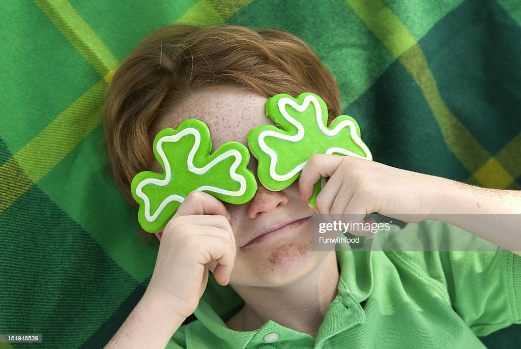 Boy Leprechaun, Smiling Irish Child & St. Patrick's Day Shamrock Cookies : Stock Photo